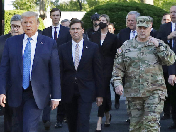 "President Trump walking from the White House to St. John's Church on June 1. Gen. Mark Milley (far right), chairman of the Joint Chiefs of Staff, was among those walking behind the president. Milley says his presence was ""a mistake"" that he has learned from, but the incident has prompted discussions about how the military can maintain nonpartisanship within the Trump administration."