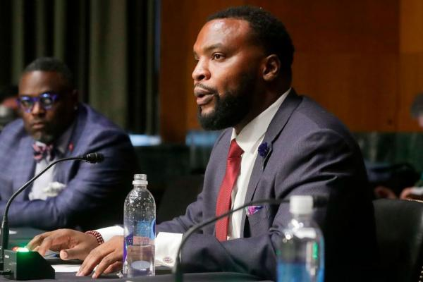 Civil rights attorney Lee Merritt testifies Tuesday during a Senate Judiciary Committee hearing to examine issues involving race and policing in the aftermath of the killing of George Floyd.