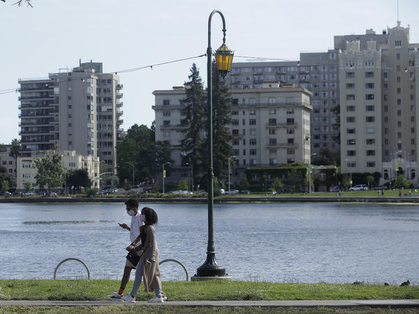 A couple walks around Lake Merritt in Oakland, where several nooses were found hanging from trees.