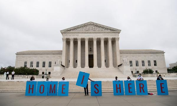 Activists demonstrate in front of the Supreme Court in Washington, D.C., on Thursday as the court rejected the Trump administration's move to rescind the Deferred Action for Childhood Arrivals program.