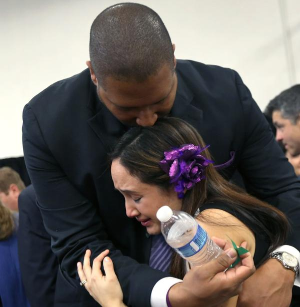 Nelba Marquez-Greene and her husband, Jimmy Greene, embrace during a news conference on Jan. 14, 2013 — one month after their daughter, Ana Grace Marquez-Greene, 6, was killed in the Sandy Hook Elementary School massacre in Newtown, Connecticut.