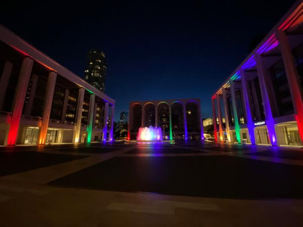 An empty Josie Robertson Plaza at Lincoln Center, lit up in June for Pride 2020 — but with no concert attendees or theatergoers, due to the coronavirus pandemic.