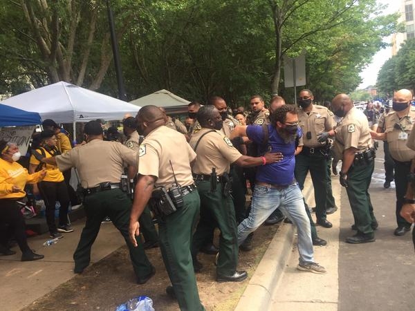 Mecklenburg sheriff's deputies remove people from the jail support station Thursday.