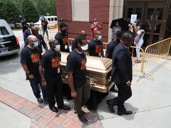 Pallbearers bring the remains of Rayshard Brooks into the Ebenezer Baptist Church for his viewing Monday in Atlanta, Georgia. Brooks was killed June 12 by an Atlanta police officer after a struggle during a field sobriety test in a Wendy's restaurant parking lot.