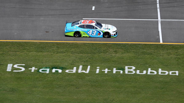 Bubba Wallace drives past the #IStandWithBubba stencil on the field prior to the NASCAR Cup Series race at the Talladega Superspeedway on June 22, 2020.