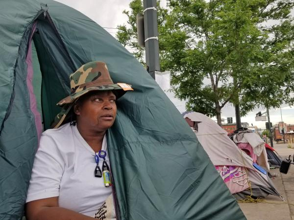 Melody Lewis moved to Denver's streets about six years ago. Last month, Lewis and hundreds of others who are homeless were displaced from sprawling, blocks-long encampments. She moved her tent, but refused to enter a shelter, partly because of the increased threat there of contracting COVID-19.