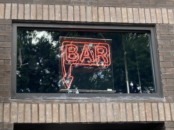 A neon sign over a bar in Columbus.