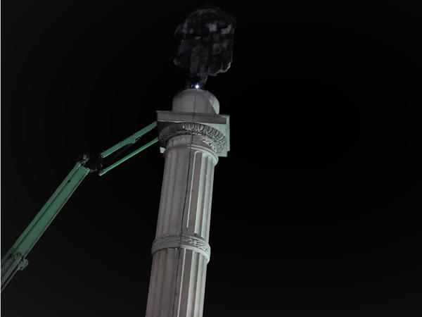 Crews prepare to remove the statue of John C. Calhoun, a former vice president and slavery advocate, early Wednesday in Charleston, S.C.