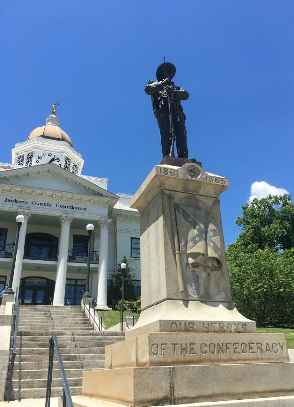 The statue known as Sylva Sam stands at the old courthouse which is now the Jackson County Public Library Complex.