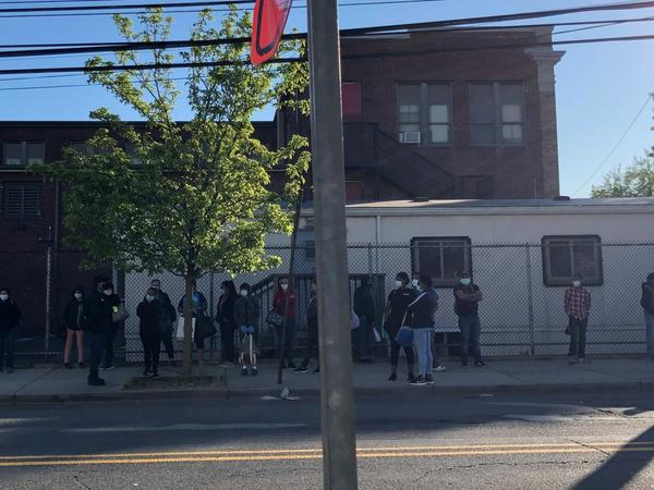 Workers wait for their ride outside On Target, a temp agency in New Brunswick, on a Monday morning in June.