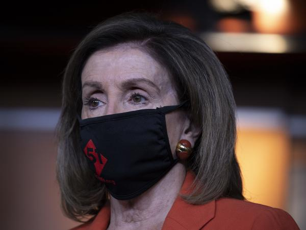House Speaker Nancy Pelosi, D-Calif., attends a press conference Friday on Capitol Hill. Pelosi told NPR that she agreed with Joe Biden that mask usage should be mandated on the federal level.