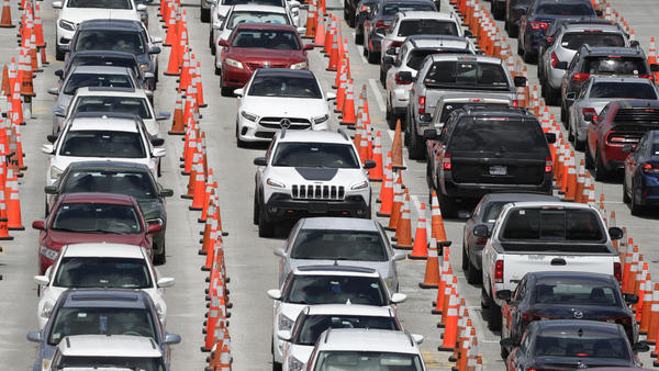 Cars line up for coronavirus testing outside Hard Rock Stadium in Miami Gardens, Fla. Florida is one of many states reporting spikes in COVID-19 cases in recent days, as the number of confirmed cases worldwide has topped 10 million.