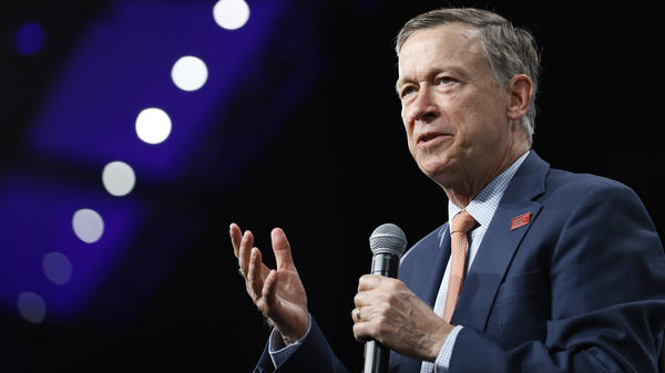 Then-Democratic presidential candidate John Hickenlooper speaks at an Iowa forum in 2019. Now the former Colorado governor is running for U.S. Senate — and locked in a battle for the Democratic primary.