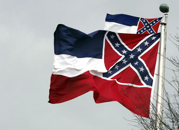 Two Mississippi state flags wave outside the Capitol in Jackson, Miss., in 2019. State lawmakers voted to retire the current flag, and Mississippi GOP Gov. Tate Reeves is expected to sign the measure.
