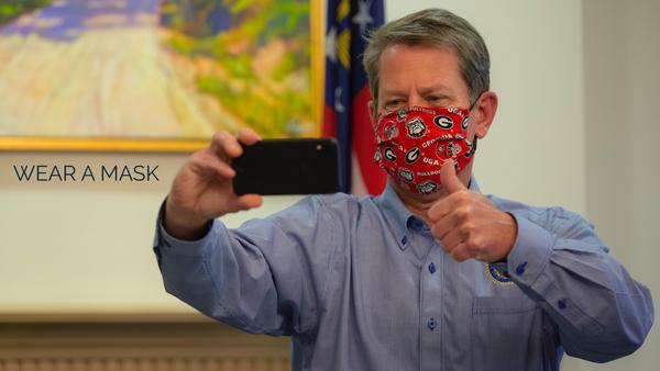 Gov. Brian Kemp shared a photo to Twitter of himself in a cloth face mask Monday, June 29, 2020.