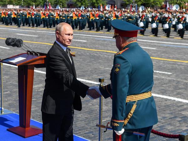 Russian President Vladimir Putin and Defense Minister Sergei Shoigu shake hands at this month's Victory Day military parade marking the 75th anniversary of Nazi Germany's defeat in World War II.