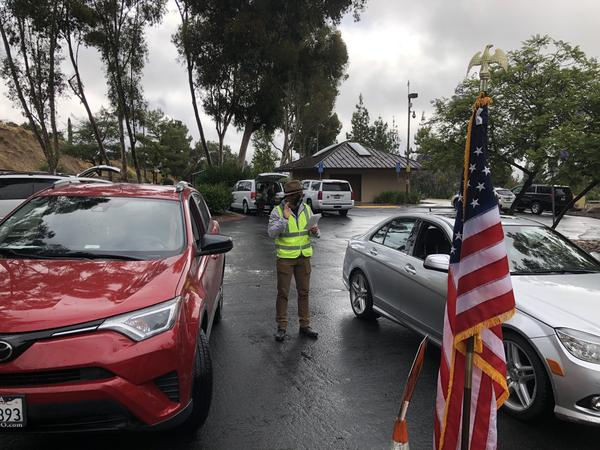 An immigration officer administers the oath of allegiance at a drive-through naturalization ceremony in El Cajon, Calif.