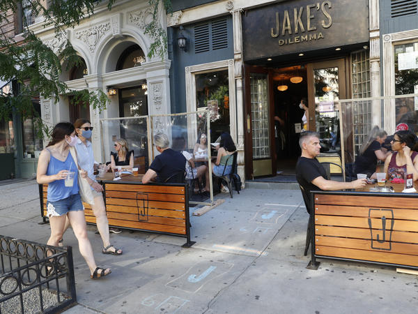 Patrons at Manhattan bar Jake's Dilemma dined outdoors on the first day it was allowed New York City. Mayor Bill De Blasio indefinitely delayed the opening of restaurants and bars for indoor dining on Wednesday.