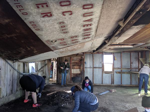 Volunteers helped clean up and stabilize abandoned buildings in Dearfield, Colo., at the annual Dearfield Day in October 2019.