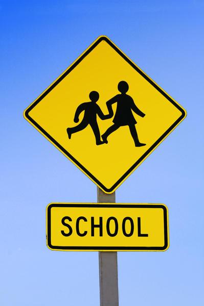 A school crossing sign.