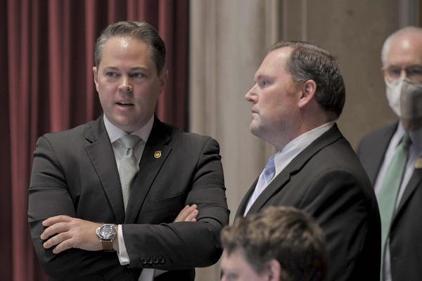 Majority Floor Leader Rob Vescovo, R-Arnold, left, and House Speaker Elijah Haahr, R-Springfield, speak during House floor debate.