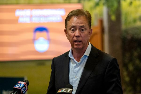 Gov. Ned Lamont speaks at Bradley International Airport about new quarantine procedures for travelers coming to Connecticut from some states with high COVID-19 infection rates.