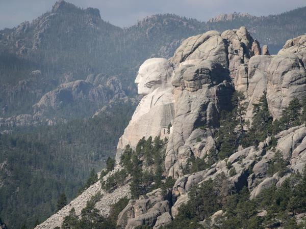 The bust of President George Washington looks out over the Black Hills at Mount Rushmore National Monument. President Trump is expected to visit the monument and make remarks before the start of a fireworks display on Friday.