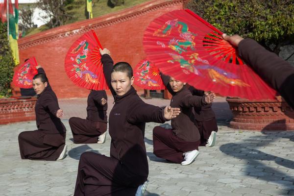 Nuns practice kung fu as a part of their daily routine at Druk Amitabha Mountain nunnery in Kathmandu, Nepal.