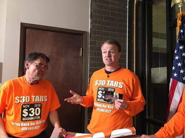 In this file photo from 2018, anti-tax activist Tim Eyman holds a news conference after dropping off petitions for his last car tab reduction ballot measure.