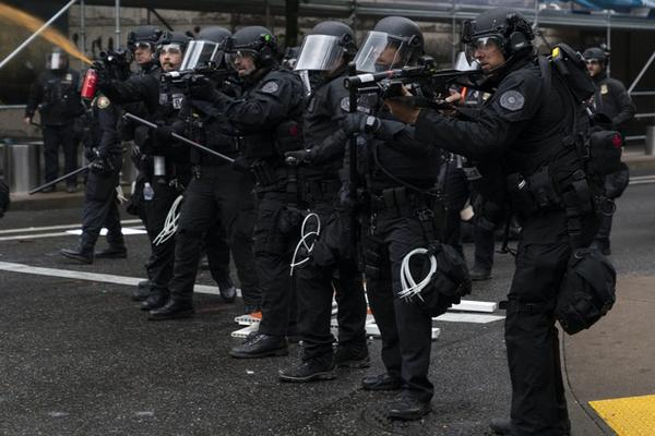 <p>Portland police fire pepper spray, FN 303 plastic munitions, and aim a 40mm launcher&nbsp;while dispersing&nbsp;protesters from near the Justice Center an hour before the 8&nbsp;p.m. curfew went into effect on May 30, 2020. The protests were against racist violence and police brutality in the wake of the Minneapolis police killing of George Floyd.</p>