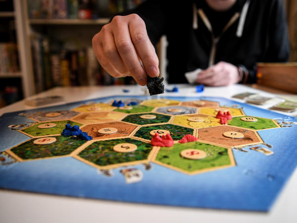 "Tim Overkamp shows the game ""The Settlers of Catan."""