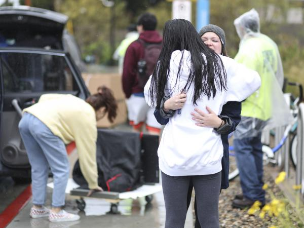 Students move out of dormitories at San Diego State University in March, after the university cancelled the rest of the semester and has asked students to move out within 48 hours. Nine percent of young adults say they've moved due to the COVID-19 pandemic.