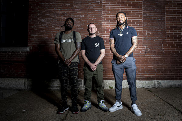 Vincent Manuel, left, Jimmy Sewell, middle, and Antoine White pose for a photo outside Mascot Agency.