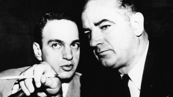 Sen. Joseph McCarthy (right) consults with attorney Roy Cohn, circa 1954. In the 1970s, Cohn would become a mentor and lawyer to Donald Trump.