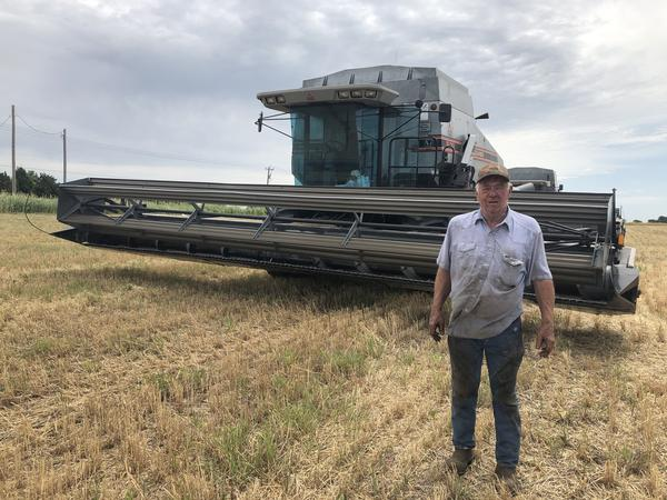 John Blair, a farmer from northwest Oklahoma County, stands in front of his wheat combine June 12. Blair has been raising wheat for decades. This year, he planted around 1,000 acres of wheat but lost part of the crop in a fire.