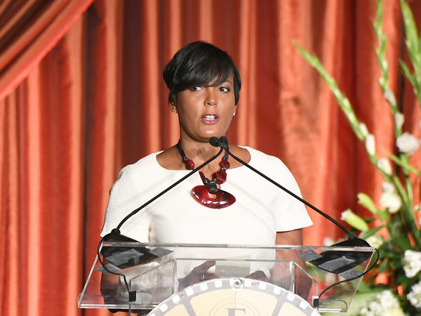 Atlanta Mayor Keisha Lance Bottoms, shown here in 2019, says a headache is her only symptom after testing positive for the coronavirus.
