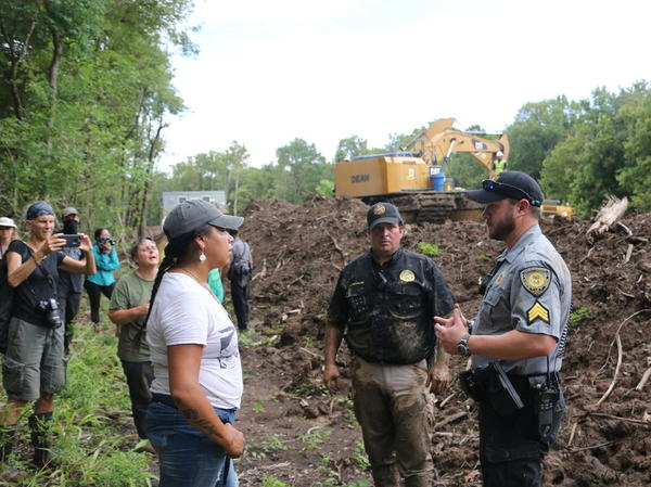 Sheriff's deputies negotiate with protesters disrupting construction of the Bayou Bridge Pipeline in Sept. 2018.