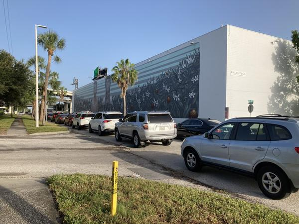 Cars lined up at drive-thru testing site at Tropicana Field in St. Petersburg. While testing has ramped up, there are still delays for receiving results.