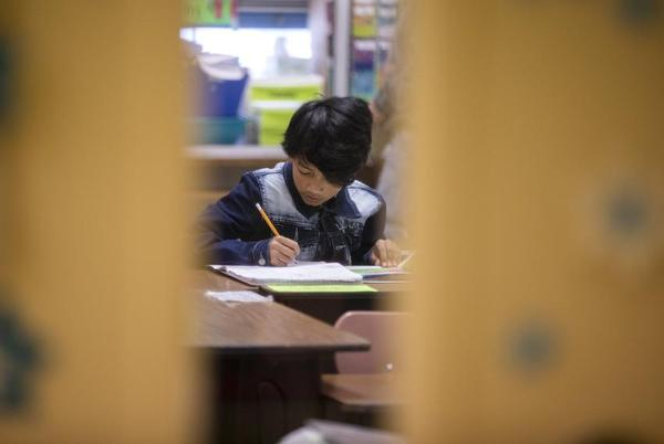 A sutdent in a classroom at Cactus Elementary School.