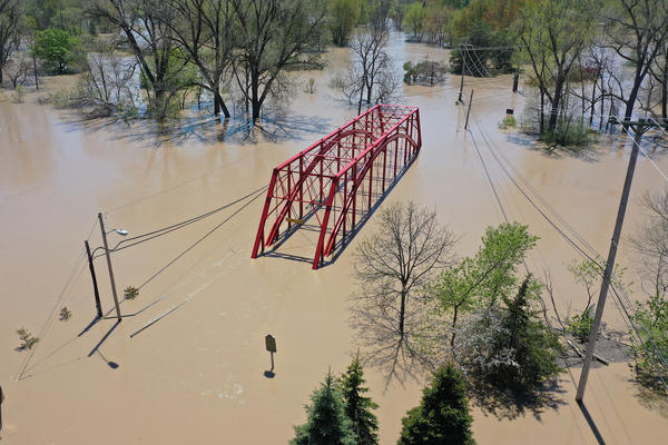 An aerial view of floodwaters flowing from the Tittabawassee River into the lower part of downtown Midland, Mich., on May 20. Thousands of residents were ordered to evacuate after two dams collapsed, causing flooding.
