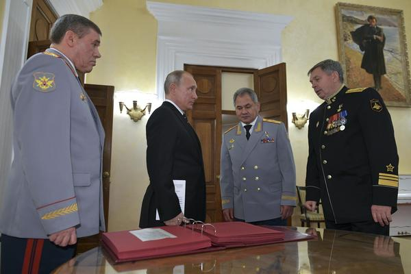 Russian President Vladimir Putin (second from left) meets military officials, including Igor Kostyukov (far right), the deputy chief of military intelligence for the GRU. The 2018 event in Moscow marked the centenary of the GRU, which has been involved in many major operations in recent years. U.S. intelligence suspects the GRU of involvement in a reported bounty program in Afghanistan.