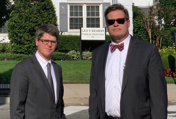 Fourth-generation funeral home director Patrick Kearns (left) and his business partner and brother-in-law Paul Kearns-Stanley stand in front of their funeral home in North Richmond Hill, Queens.