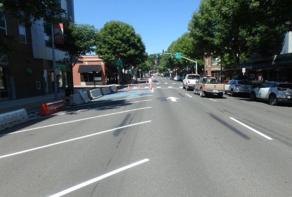 Pullman's downtown one-way traffic was previously three lanes. A recent test added angle parking and a protected bike lane to study traffic flow and pedestrian use.