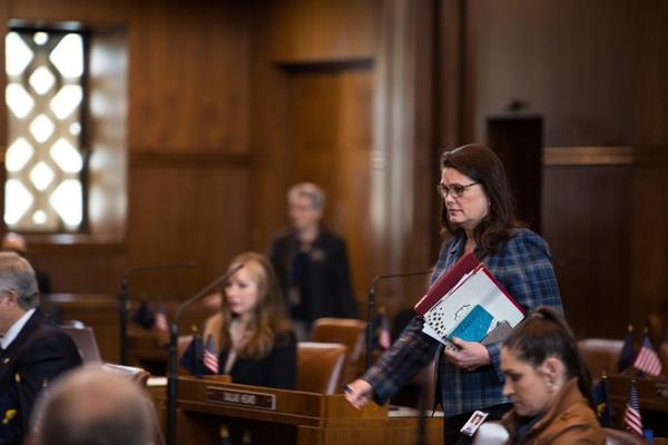 State Sen. Sara Gelser takes her seat in the Senate chamber at the Capitol in Salem, Ore., Tuesday, April 2, 2019. Gelser introduced language in a measure Tuesday to require the state Department of Human Services to present a plan to minimize out-of-state placement for children in foster care.