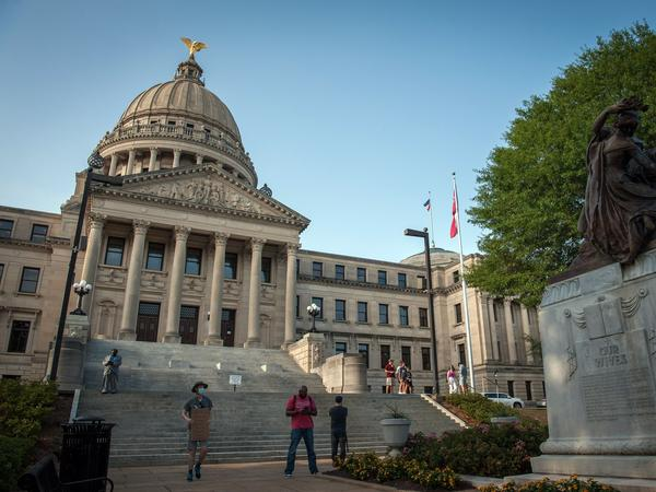 At least 26 Mississippi legislators have tested positive for the coronavirus after working at the Capitol, often without observing social distancing or wearing face masks.