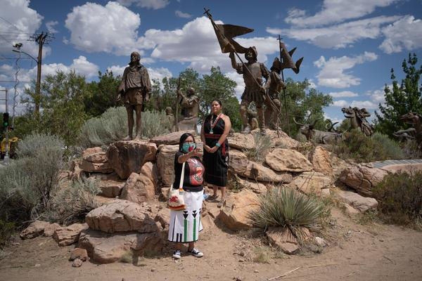 Channing Concho, left, and American Horse photograph themselves in front of a memorial after a sculpture of Spanish conquistador Juan de Onate was removed on June 16, 2020 in Albuquerque.