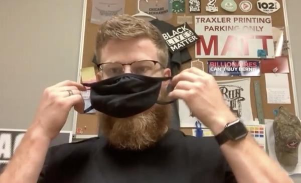 Zachary Traxler, Traxler Printing, demonstrates mask