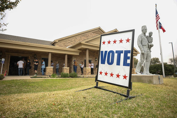 Voters wait in line at the Ben Hur Shrine Temple in Austin on March 3.