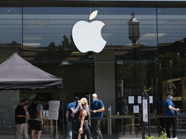 People enter an Apple Store at  in Glendale, Calif., on June 23.The second-highest court in the European Union says Ireland's tax break for Apple did not represent an unfair advantage.
