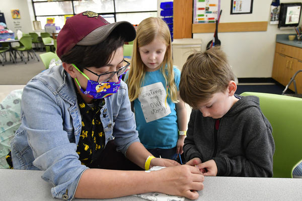 Elementary school students in Kansas won't be expected to wear masks unless they've been sent to the nurse with COVID-19 symptoms. Students older than 12 will have to wear masks, and the Kansas plan to reopen schools calls for having them help make masks and plexiglass barriers.